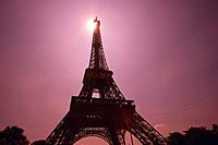 Image of the Eiffel Tower By Sunset, the Sun Visible on the Top of the Tower, Low Angle View, Lens Flare, Paris, France