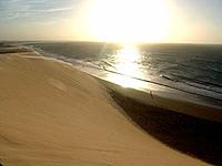 jericoacoara beach dunes with solar rays at sea