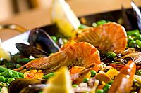Paella with prawns, peas and octopus detail