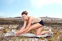 South Africa, Cape Town, Young woman exercising yoga