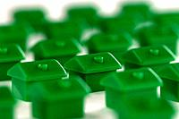 Green plastic miniature houses