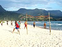 men people playing soccer at sao paulo beach sands