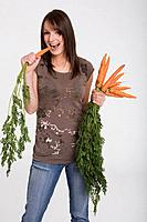 Young girl holding carrots