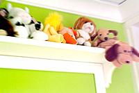 a girl bedroom with teddy bears