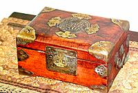 a closed wooded oriental decorative box