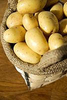 Potatoes in jute bag, elevated view