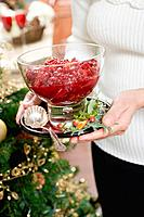 Woman holding bowl of cranberry sauce Christmas