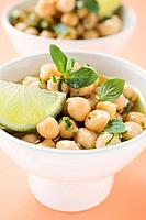 Chick_peas with lime wedges and herbs close_up