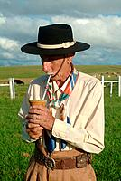 a gaucho tipical man person drinking chimarrao