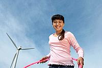 Girl 7_9 holding hula hoop at wind farm portrait