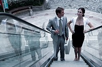 Businessman and businesswoman standing on staircase