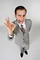 Businessman gesturing sign language, portrait