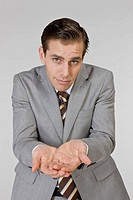Businessman gesturing sign language, portrait