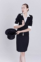 Businesswoman holding a top hat and a magic wand