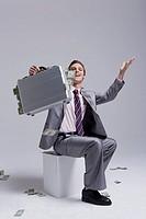 Young businessman holding briefcase, portrait