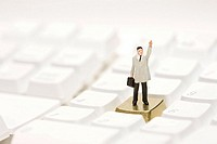 Figurine on keyboard