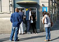 France. Paris. Gare De Lyon. People at an automated teller machine