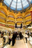 Shoppers under the domed central area of Galeries Lafayette, Paris, France