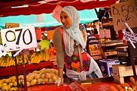 Vendor selling fruit at Porta Palazzo market, Piazza della Repubblica, Turin, Italy