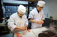 Japan, Kyoto, two master's preparing pastry  Wagashi, types of colourful Japanese sweets