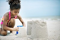 Little Girl Building a Sand Castle