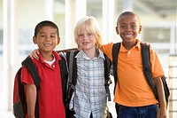 Three students outside school standing together smiling selective focus