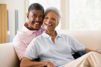Couple relaxing in living room and smiling