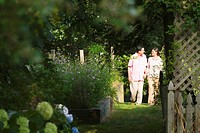 Mature couple walking in a garden