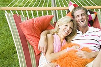 Portrait of a mature couple lying in a hammock and smiling