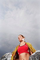 Female athlete holding thermal blanket low angle view
