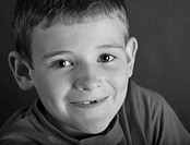 Boy smiling, portrait B&W