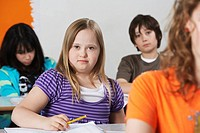 Portrait of girl 10_12 with Down syndrome in classroom
