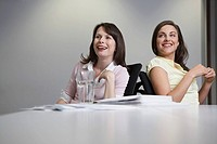 Two women sitting at desk