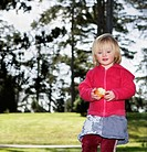 Girl 3_4 with apple outdoors