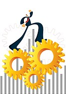 A businessman running on turning gears