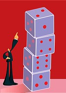 Businessman pointing at a stack of dice