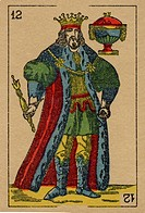 Vintage playing card showing a king holding a sceptre and an urn