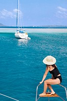 Woman on the front of a sailboat, British Virgin Islands