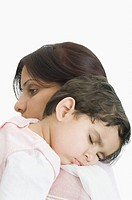 Close_up of a girl sleeping on her mother´s shoulder