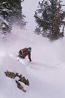 A woman skiing powder snow in the Sawtooth mountains near Stanley ID