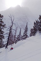 A man skiing powder snow in the Sawtooth Mountains of Idaho near Mount Williams