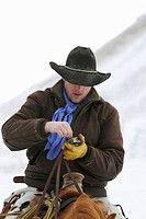 A cowboy taking a pinch of snuff, Shell Wyoming