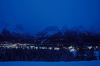 Overview of Canmore on cold winters night with Ha Ling Peak and Rundle Range behind CANADA Alberta