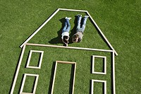 Couple laying inside house outline (thumbnail)