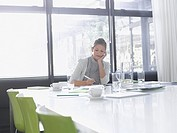 Businesswoman working at conference table
