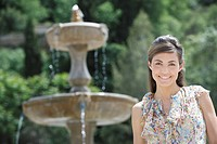 Woman smiling near fountain