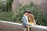 Couple hugging on stone wall