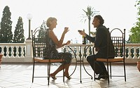 Couple having wine on balcony
