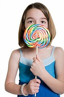 Girl holding a lollipop