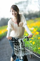 Young Woman Riding on Bicycle, Differential Focus, Front View